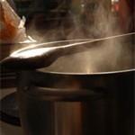 Bild Dampfender Kochtopf