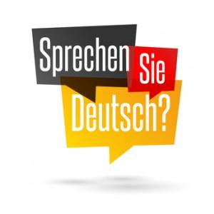 Bild: Eckige Sprechblasen mit dem Schriftzug Sprechen (Schwarz) - Sie (rot) - Deutsch (Gelb)